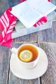Tea with lemon in cup — Stock Photo