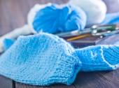 Blue knitting on a table — Stock Photo