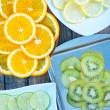 Kiwi and citrus slices — Stock Photo #67492773