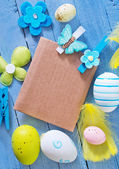 Easter eggs on blue table — Stock Photo