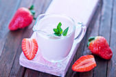 Strawberry yogurt in glass jug — Stock Photo