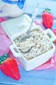 Oat flakes with strawberry — Stock Photo