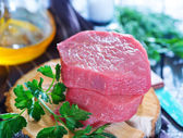 Raw meat and parsley — Stock Photo