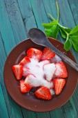 Strawberry with sugar on plate — Stock Photo