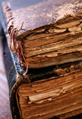 Old books on the wooden table — Stock Photo
