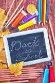 School supplies and black board — Stock Photo