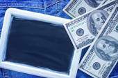 Dollars and black board — Stock Photo