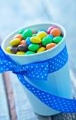 Color candy in paper cup — Stock Photo
