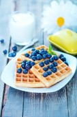 Waffle with blueberry on plate — Stock Photo