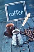 Coffee beans on the wooden table — Stock Photo