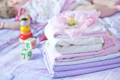 Baby clothes on the bed — Stock Photo