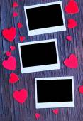 Paper hearts and photo — Stock Photo