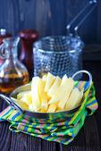 Raw potato in metal bowl — Stock Photo