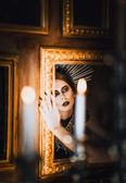 Mysterious portrait of beautiful goth girl looking into mirror — Foto Stock