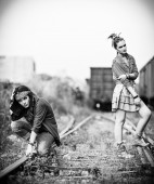 Two sad grunge girls at a railroad — Stock Photo