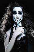 Young woman in the image of sad gothic freak clown with scissors — Foto Stock