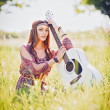 Portrait of pretty young hippie girl with guitar. Outdoor shot — Stock Photo #76041617