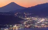 Lights of Suwa city and Mt.Fuji at dawn — Stock Photo