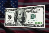 100 dollar bill on a background of the US flag — Stock Photo