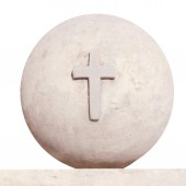 Cross on a background of the earth (statue) — Stock Photo