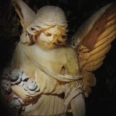 Vintage image of a sad angel on a cemetery — Stock Photo