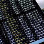 Departures flight information schedule in international airport — Stock Photo #54849717