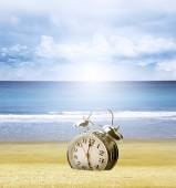 Clock in sand — Stock Photo