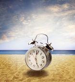 Clock in sand — Stock Photo