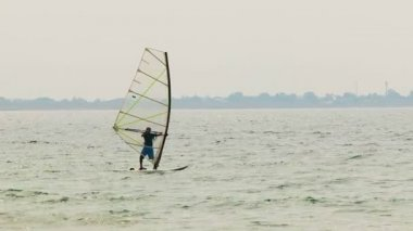 Windsurfer Slowly Sailing in the Sea — Stock Video