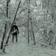 Young Man Walking in Winter Forest — Stock Video #66990351