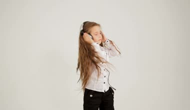 Little Girl Listening to Music With Headphones And Dancing. Locked Down Video shot. — Stock Video
