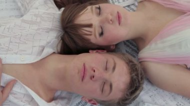 Young Man And Woman Lying Together. Open Eyes — Stock Video