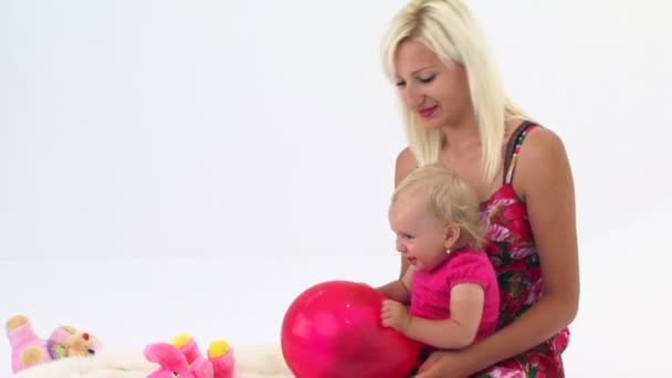 Mother And Her Baby Playing With Pink Balloon — Vídeo de stock
