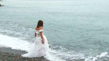Beautiful Woman In White Dress Walking Into Sea — Stock Video