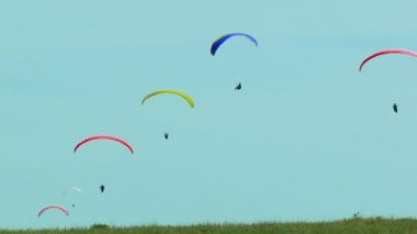 Several Paragliders Flying In The Blue Sky — Stock Video