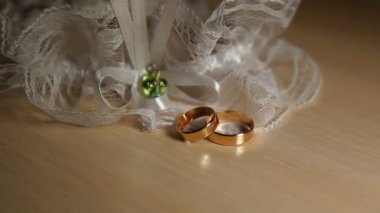 Two Wedding Rings With Lace On The Table — Stock Video