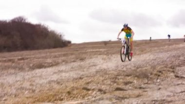EDITORIAL. Young Professional Cyclists Racing Fast Downhill  During Competition At Dull Day — Stock Video