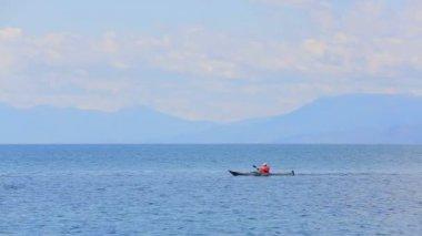Man Rowing In Canoe In The Sea — Stock Video