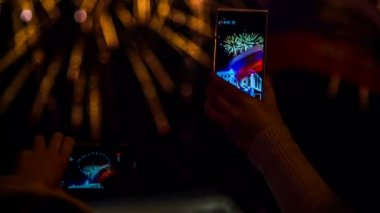 Two Spectators Filming Fireworks Using Smartphones — Stock Video