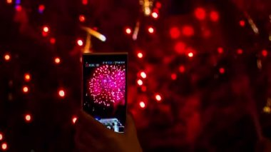 One Person Making A Video Of Fireworks Using Smartphone — Stock Video