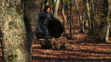 Woman In Black Running In Autumn Forest — Stock Video