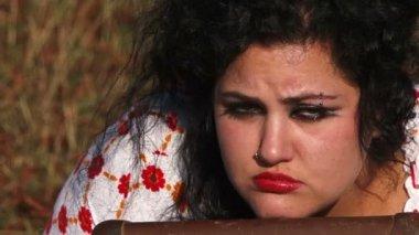 Sad Dark Haired Woman Looking At Camera At Nature — Stock Video