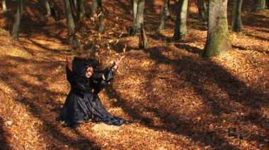 Woman In Black Playing With Leaves In Autumn Forest — Stock Video