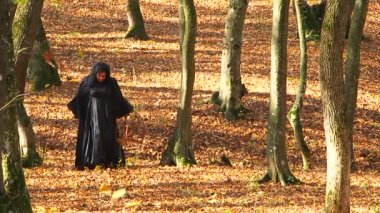 Woman In Black Walking In Autumn Forest — Stock Video