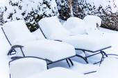 Snow-covered garden furniture — Stok fotoğraf