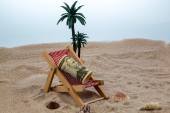 Beach chair with piggy bank and dollars — Stock Photo