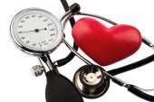 Sphygmomanometer and heart — Stock Photo