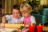 Children baking cookies for christmas — Stock Photo