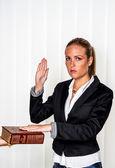 Woman swears on the bible — Stock Photo