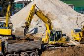 Excavator at construction site during excavation — Stock Photo